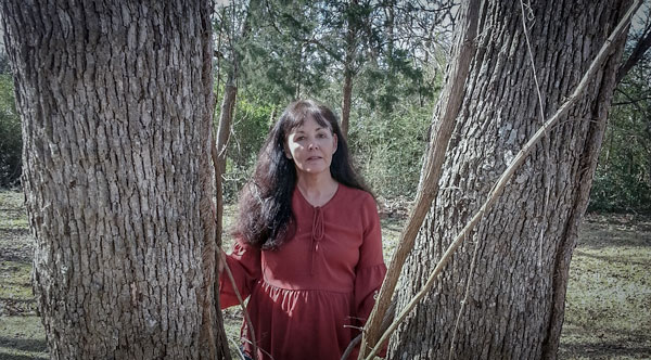 Mary Alford Christian Suspense Author photo with trees in background